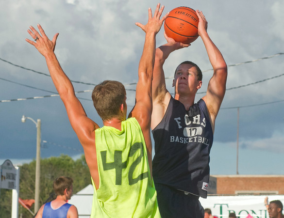 SAM HOUSEHOLDER | THE GOSHEN NEWS<br /> Brady Lantz, Goshen, shoots over Andy Curry, Syracuse, Wednesday during the three on three tournament at the Elkhart County 4-H Fair.