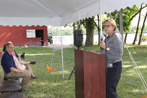 SHEILA SELMAN | THE GOSHEN NEWS<br /> Goshen Parks Superintendent Sheri Howland addresses the group of people who came out for the dedication of Fidler Pond Park Saturday morning.