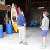 SHEILA SELMAN | THE GOSHEN NEWS<br /> Ron and Carol Johnson, left, speak with park department employee Rachel Thornburg in the barn at Fidler Pond Park where people can rent kayaks, canoes and pedal boats.