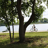 SHEILA SELMAN | THE GOSHEN NEWS<br /> Bicyclists enjoy the trail around Fidler Pond during the dedication ceremony of Fidler Pond Park Saturday morning.