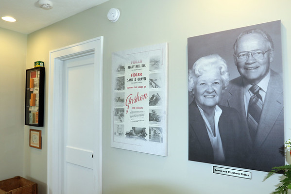 SHEILA SELMAN | THE GOSHEN NEWS<br /> A display features a sign about Fidler Ready Mix Inc. and Fidler Sand & Gravel along with a photo of Fidler founder Lewis Fidler and his wife, Elizabeth.