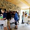 SHEILA SELMAN | THE GOSHEN NEWS<br /> People line up to grab snacks and drinks inside Chiddister Pavilion following the dedication of Fidler Pond Park Saturday in Goshen.