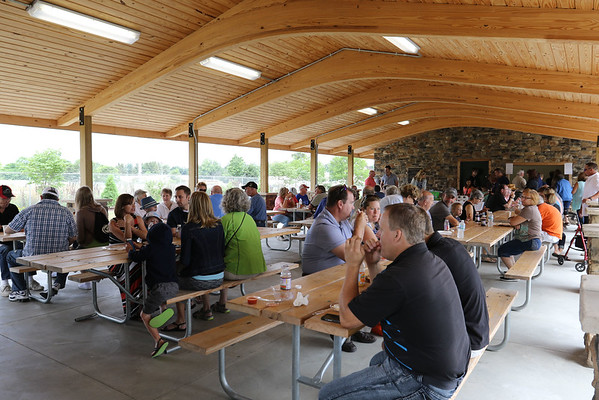 SHEILA SELMAN | THE GOSHEN NEWS<br /> People enjoy snacks and drinks inside Chiddister Pavilion following the dedication of Fidler Pond Park Saturday in Goshen.