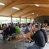 SHEILA SELMAN | THE GOSHEN NEWS<br /> People enjoy snacks and drinks inside Chiddister Pavilion following the dedication of Fidler Pond Park Saturday in Goshen.