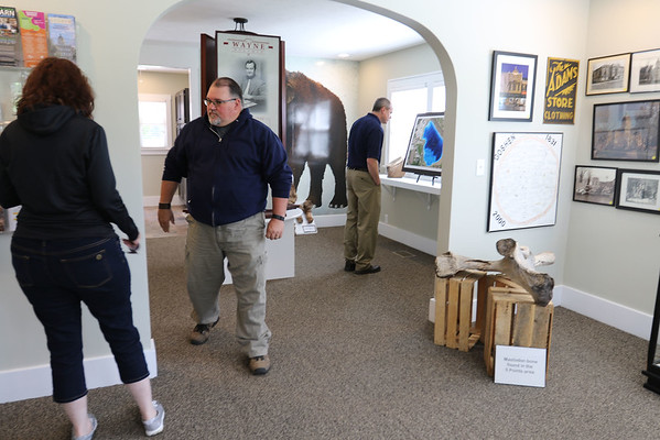 SHEILA SELMAN | THE GOSHEN NEWS<br /> Carol and Ron Johnson, South Bend, look at the displays at the Wayne Wogoman Welcome Center at the front of Fidler Pond Park Saturday.