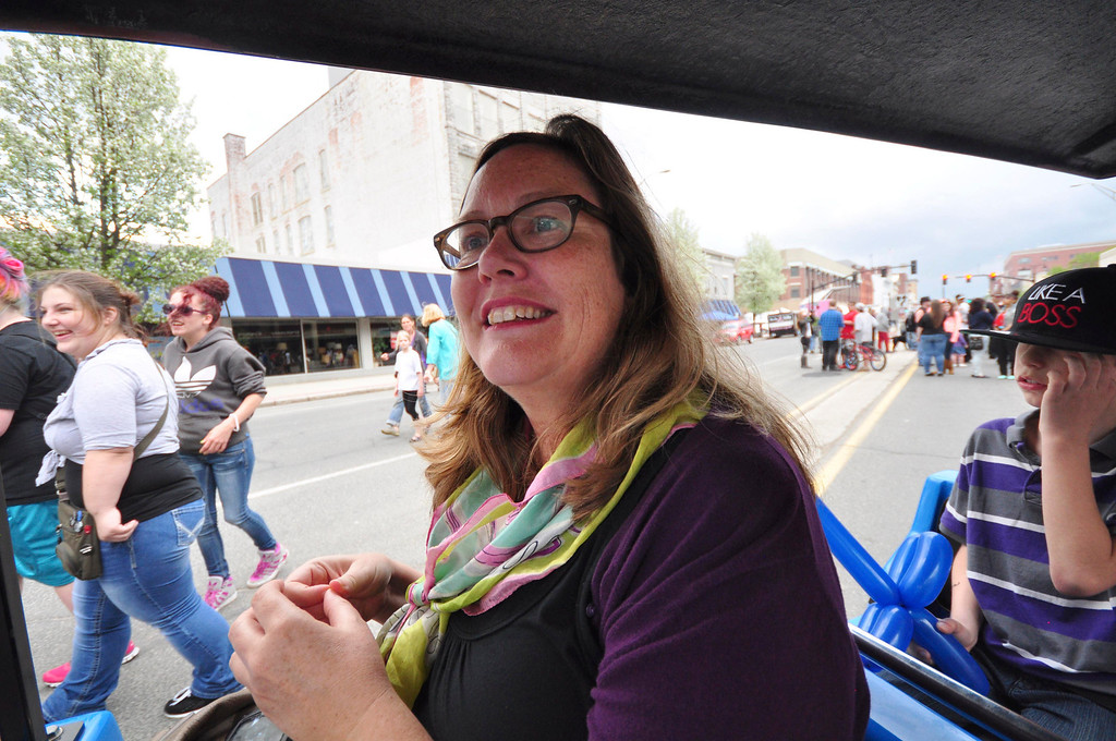 . Cultural Development Director Megan Whilden rides the train during the first Third Thursday of the season on May 15, 2014. Whilden, who has been instrumental in the organizing of the event since it began, is leaving her position with the city. Today is her last day. Gillian Jones / Berkshire Eagle Staff / photos.berkshireeagle.com