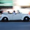 HALEY WARD | THE GOSHEN NEWS<br /> A Volkswagen Beetle drives down Main Street during First Fridays Cruisin' Reunion on Friday.