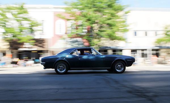 HALEY WARD | THE GOSHEN NEWS<br /> A classic car drives down Main Steet during First Fridays Cruisin' Reunion on Friday.