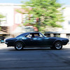 HALEY WARD | THE GOSHEN NEWS<br /> A classic car drives down Main Steet during First Fridays Cruisin' Reunion on Friday.