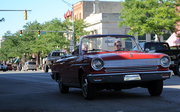 HALEY WARD | THE GOSHEN NEWS<br /> A convertible drives past during First Fridays Cruisin' Reunion on Friday on Main Street.