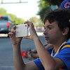 HALEY WARD | THE GOSHEN NEWS<br /> Christian Boyd, 10 from Elkhart, takes a photo as cars drive down Main Street during First Fridays Cruisin' Reunion on Friday. He said he liked both old and new cars.