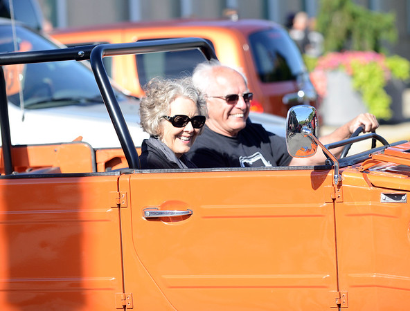 HALEY WARD | THE GOSHEN NEWS<br /> A couple drives past during First Fridays Cruisin' Reunion on Friday on Main Street.