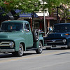 HALEY WARD | THE GOSHEN NEWS<br /> A pair of trucks drive down Main Street during First Fridays Cruisin' Reunion on Friday.