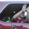 HALEY WARD | THE GOSHEN NEWS<br /> A kid waves at the crowd from a classic car during First Fridays Cruisin' Reunion on Friday on Main Street.