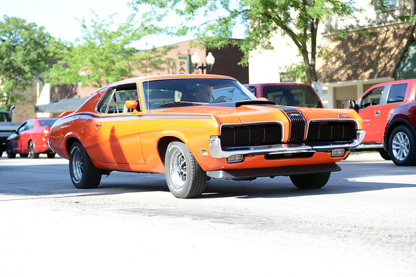 HALEY WARD | THE GOSHEN NEWS<br /> A Mercury Cougar drives past during First Fridays Cruisin' Reunion on Friday on Main Street.