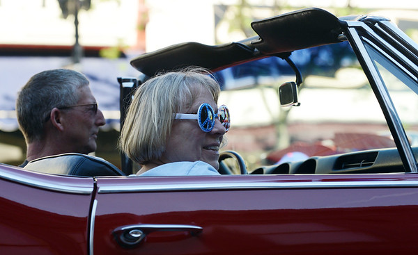 HALEY WARD | THE GOSHEN NEWS<br /> A women smiles at the crowd during First Fridays Cruisin' Reunion on Friday on Main Street.