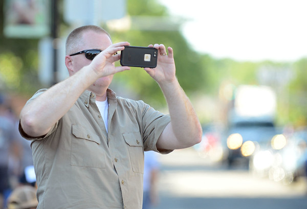 HALEY WARD   THE GOSHEN NEWS<br /> Chris Shakley takes a photo of a car during First Fridays Cruisin' Reunion on Friday on Main Street. Shakley went to Goshen High School, graduating in 1984, and he remembers driving his 1968 Ford Tourneo before the event was shut down.