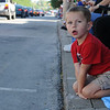 HALEY WARD | THE GOSHEN NEWS<br /> Mason Murphy, 4 from New Paris, stares at the cars during First Fridays Cruisin' Reunion on Friday on Main Street.