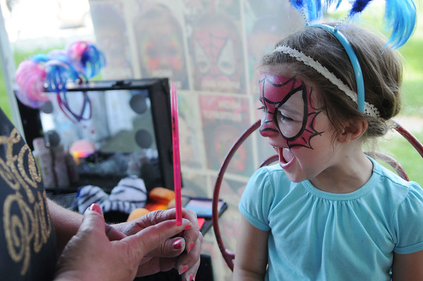 HALEY WARD | THE GOSHEN NEWS<br /> Miranda Mattern, 3, reacts to her Spider Girl face paint done by Rhonda Wilson during First Fridays in downtown Goshen.