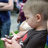 HALEY WARD | THE GOSHEN NEWS<br /> Luke Borke, 2, holds a turtle brought by Clean River Healthy Neighborhoods during First Fridays in downtown Goshen.