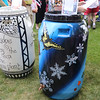 SHERRY VAN ARSDALL | THE GOSHEN NEWS<br /> Some of the decorated rain barrels up for auction during the 8th annual rain barrel auction during June First Fridays Sweet Summer Kick-off in downtown Goshen.