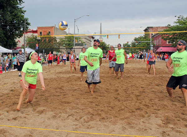 Roger Schneider | The Goshen News<br /> KIERSTEN REEVE attempts to  get a deep ball during a sand volleyball match on Lincoln Avenue during First Fridays Sandblast.