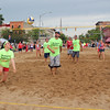 Roger Schneider | The Goshen News<br /> KIERSTEN REEVE attempts to  get a deep ball during a sand volleyball match on Lincoln Avenue during First Fridays Sandblast.