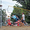 Roger Schneider | The Goshen News<br /> HANNAH CURTIS watches as a competitor tries to return her shot during the Sandblast volleyball tournament Friday night. In the background is Pamela Pedersen.