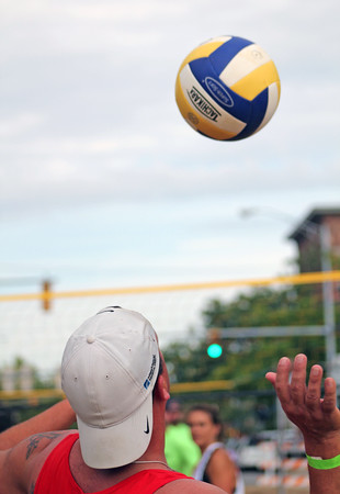 Roger Schneider | The Goshen News<br /> A COMPETITOR in the sand volleyball tournament  at First Fridays tosses up a serve.