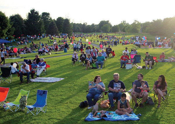JOHN KLINE | THE GOSHEN NEWS<br /> Attendees of the 2016 Celebrate America event and fireworks display claim their spots at the Black Squirrel Golf Course in Goshen before the kickoff of the festivities at 8:45 p.m. Sunday.