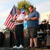 JOHN KLINE | THE GOSHEN NEWS<br /> Gregg Lanzen, president of Goshen's Celebrate America organization, left, and Doug Moore of the local radio station WFRN, provide the opening remarks during Sunday's Celebrate America festivities at the Black Squirrel Golf Course in Goshen.