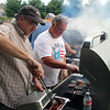 JOHN KLINE | THE GOSHEN NEWS<br /> Goshen First United Methodist Church volunteers Ron Breniser, left, and Steve Kuiper work the grill during the church's annual Big Bash event Sunday in Goshen.