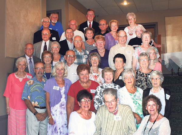 SHEILA SELMAN | THE GOSHEN NEWS<br /> Members of the Goshen High School class of 1956 celebrated with a reunion Saturday at Maplecrest Country Club. In front, from right, are Pat Cooper, Mark Maire and Carol Darr. In the second row are Sharon O'Neill, Joan Rae Eshelman, Barbara Wagner King, Nancy (VandDer Maas) Eckelbarger, Nancy (Ganger) Zeiger and Phillip Payne. In the third row are Dorothy (Bailey) Firestone, Janet Fry VanderWay, Dorene Hostetler Cripe, Loretta A. Bryant Eshelman, Ed Farmwald, Dottie Koerner and Carolyn Nelson McFarland. In the fourth row are Barbara (Culp) Grooms, Charles R. Stauffer, Virginia (McCabe) Scott, Joe Bill Swihart, Norine (Boyts) Hartzler and Larry Hartzler. In the fifth row are Sandra Wheeler, Wanda (Fisher) Wyland, Doris (Roth) Kopfenstein, Dan Stump and Bob Yoder. In the sixth row are Tatsy (Bradford) Hayes, Lanny Scott, Gene Inbody and Larry Essig. In the back row are Kohler Champion and Jon Bontrager.