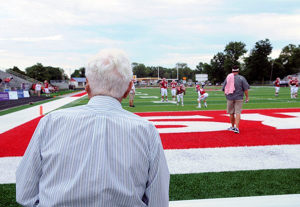 Haley Ward | The Goshen News<br /> Don Park of Goshen takes a look at the new artificial turf covering Foreman Field before the first football game of the year Friday night.
