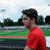 Haley Ward | The Goshen News<br /> Dave Marshall, a Goshen High School alumni, takes a look at the new artificial turf covering Foreman Field before the first football game of the year Friday night.