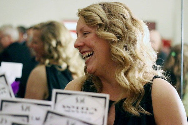 LYNNE ZEHR| THE GOSHEN NEWS<br /> Adela Hufford enjoys the silent auction before the viewing of Admit One.