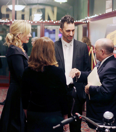 LYNNE ZEHR| THE GOSHEN NEWS<br /> Mayor Jeremy Stutsman, Maija Stutsman and Gina Leichty talk with Jeffey Marks before his remarks about the history of the Goshen Theater.