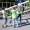 HALEY WARD | THE GOSHEN NEWS<br /> Miranda Starks, Robin Hill and Bryan Courtney carry the framing for the interior a wall during a build for Habitat for Humanity of Elkhart County on Wednesday at a Robert Weed Plywood parking lot in Bristol. The three were volunteers from Robert Weed Plywood.