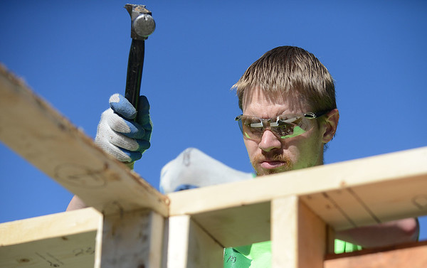 HALEY WARD | THE GOSHEN NEWS<br /> Tim Kohler nails the framing together during a build for Habitat for Humanity of Elkhart County on Wednesday. Volunteers built the house for Toya Sheppard and her three children Genice Crawford, Genoris Crawford and Angell Sheppard. They were all present at the build.