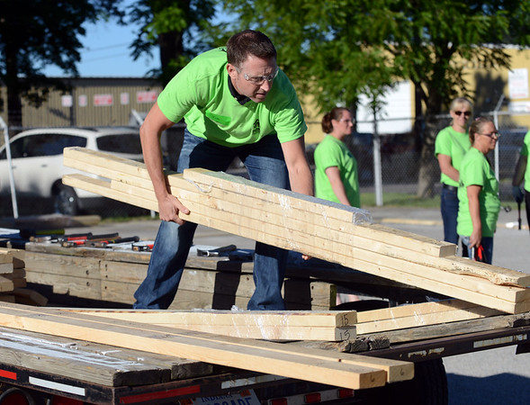 HALEY WARD   THE GOSHEN NEWS<br /> Jim Campau unloads lumber during a build for Habitat for Humanity of Elkhart County on Wednesday at a Robert Weed Plywood parking lot in Bristol. Habitat for Humanity of Elkhart County hopes to complete seven builds for their next year.