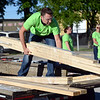HALEY WARD | THE GOSHEN NEWS<br /> Jim Campau unloads lumber during a build for Habitat for Humanity of Elkhart County on Wednesday at a Robert Weed Plywood parking lot in Bristol. Habitat for Humanity of Elkhart County hopes to complete seven builds for their next year.