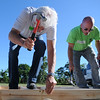 HALEY WARD | THE GOSHEN NEWS<br /> David Weed, President of Robert Weed, and Steve Caligiuri drive nails into a frame during a Habitat for Humanity build on Wednesday in Bristol. Majority of the volunteers were from Robert Weed, and throughout the day about 55 people worked on the house.