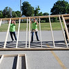 HALEY WARD | THE GOSHEN NEWS<br /> Volunteers raise one of the exterior walls during a Habitat for Humanity build for Elkhart County on Wednesday at a Robert Weed Plywood parking lot in Bristol. This was the first time Habitat for Humanity in Elkhart County has raised the walls in a parking lot.