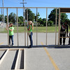 HALEY WARD | THE GOSHEN NEWS<br /> Volunteers hold up the framing for an exterior wall during a Habitat for Humanity build for Elkhart County on Wednesday at a Robert Weed Plywood parking lot in Bristol. This was the first time Habitat for Humanity in Elkhart County has raised the walls in a parking lot.