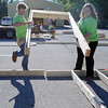 HALEY WARD | THE GOSHEN NEWS<br /> Jeff Smith and Jennifer Rambow, employees at Robert Weed Plywood, move a door frame to the frame of an exterior wall during a Habitat for Humanity build of Elkhart on Wednesday in Bristol. Majority of the volunteers were from Robert Weed, and throughout the day about 55 people worked on the house.