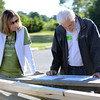 HALEY WARD | THE GOSHEN NEWS<br /> Amy Zakiewicz, Director of Development with Habitat for Humanity, and David Weed, President of Robert Weed, look over the layout of Toya Sheppard's home during a build for Habitat for Humanity of Elkhart County for Elkhart County on Wednesday. Robert Weed Plywood donated the supplies and provided the volunteers.