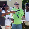 HALEY WARD | THE GOSHEN NEWS<br /> Angell Sheppard, Toya Sheppard, Graham Thornton and Genoris Crawford look at the layout of Sheppard's new house during a build for Habitat for Humanity of Elkhart County on Wednesday. Robert Weed Plywood donated the supplies and provided the volunteers.
