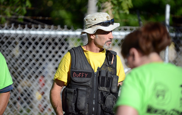 HALEY WARD | THE GOSHEN NEWS<br /> Duffy Sherman, Construction Manager for Habitat for Humanity of Elkhart County, gives instructions to volunteers during a build on Wednesday. Robert Weed Plywood donated the supplies and provided the volunteers.