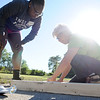 HALEY WARD | THE GOSHEN NEWS<br /> Genice Crawford looks over Molly Prime, volunteer coordinator with Habitat for Humanity, while building the door frame during the build on Wednesday at a parking lot in Bristol. Crawford was helping build the home for her mom Toya Sheppard.