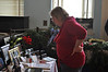Jill Greene, from Pittsfield, looks at some pictures at the Holiday Gift Extravaganza Bazaar at the Houghton Mansion Saturday. The bazaar benefited the Northern Berkshire Santa Fund. (Jack Guerino/North Adams Transcript)